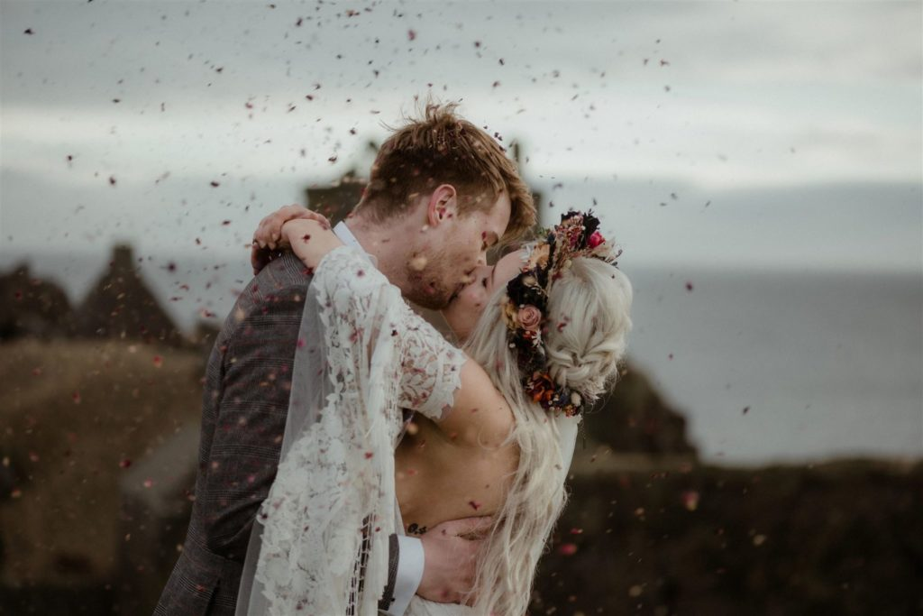 Bride and groom kiss with cobfetti at a Scottish elopement wedding