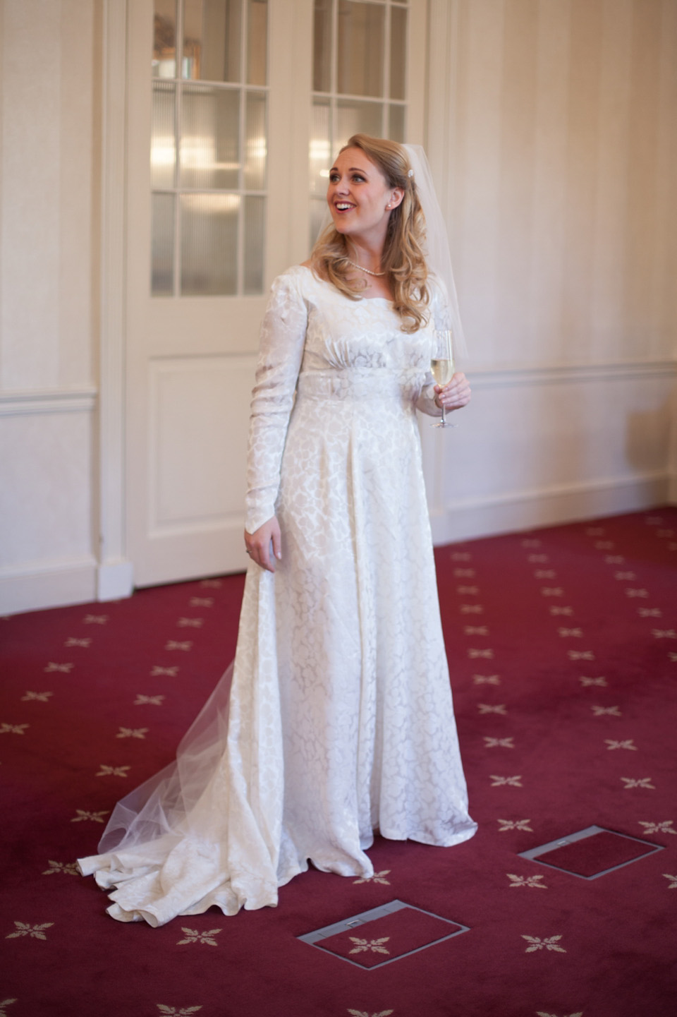 A 1940s Vintage Elizabeth Avey Long Sleeved Gown For A Traditional