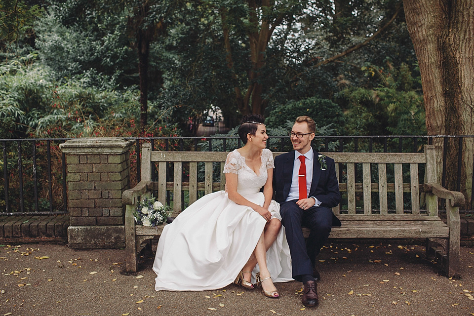 A Wedding Dress With Pockets And A Pair Of Gold Sparkly Peep Toe