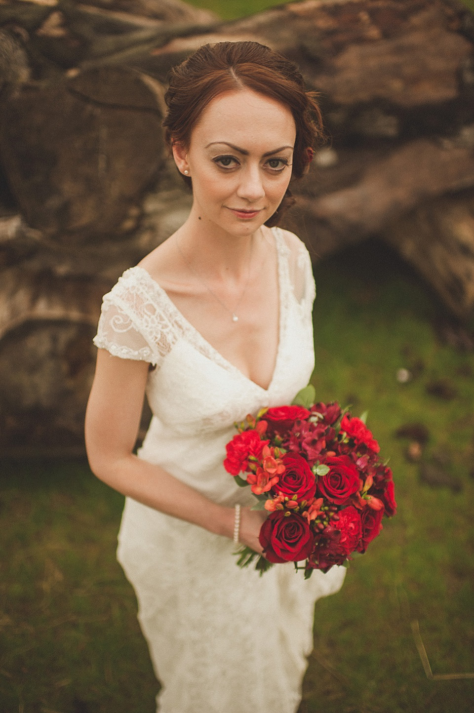 red roses in her hair for a relaxed and rural farm wedding   love