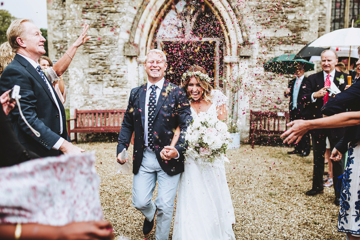 Jessica wore a Claire Pettibone gown from Ellie Sanderson in Surrey for her country village wedding that was full of fun and charm. Photography by Frankee Victoria.