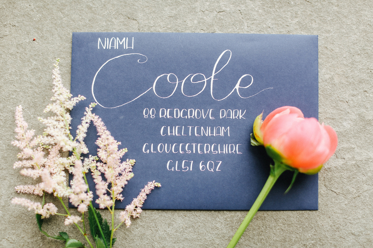 Dark blue envelope and white ink wedding stationery - A Caroline Castigliano Gown for a Chic and Classic Manor House Wedding in Shades of Peach