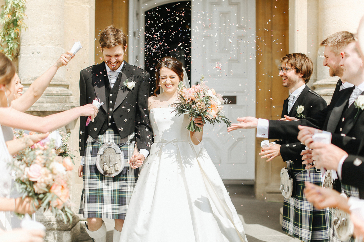 Confetti shot - A Caroline Castigliano Gown for a Chic and Classic Manor House Wedding in Shades of Peach