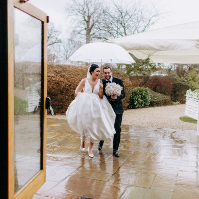 Pronovias + Black Tie for Two Childhood Sweethearts and their Fun, Rainy Day Barn Wedding