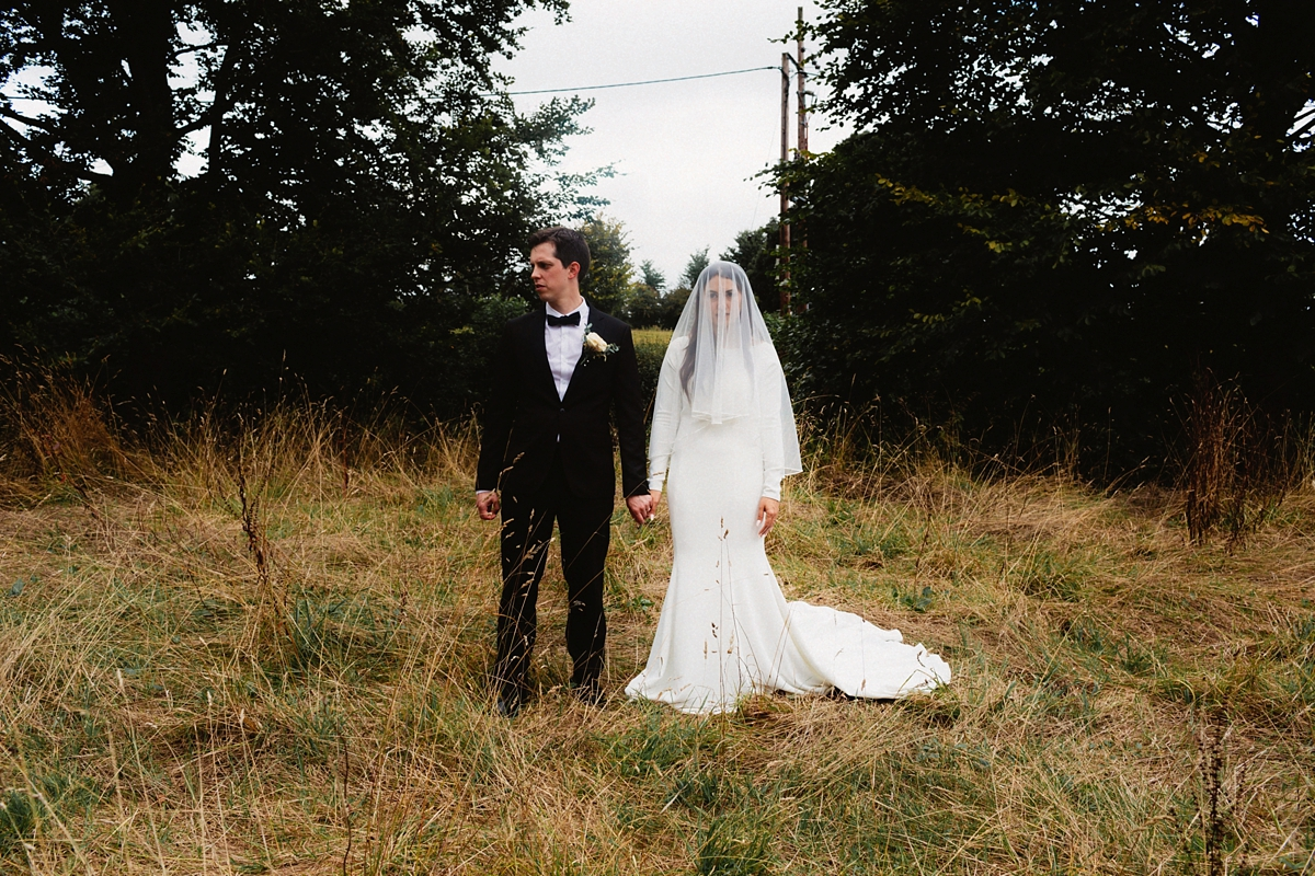 A Long Sleeved Justin Alexander Gown For A Tinder Couple