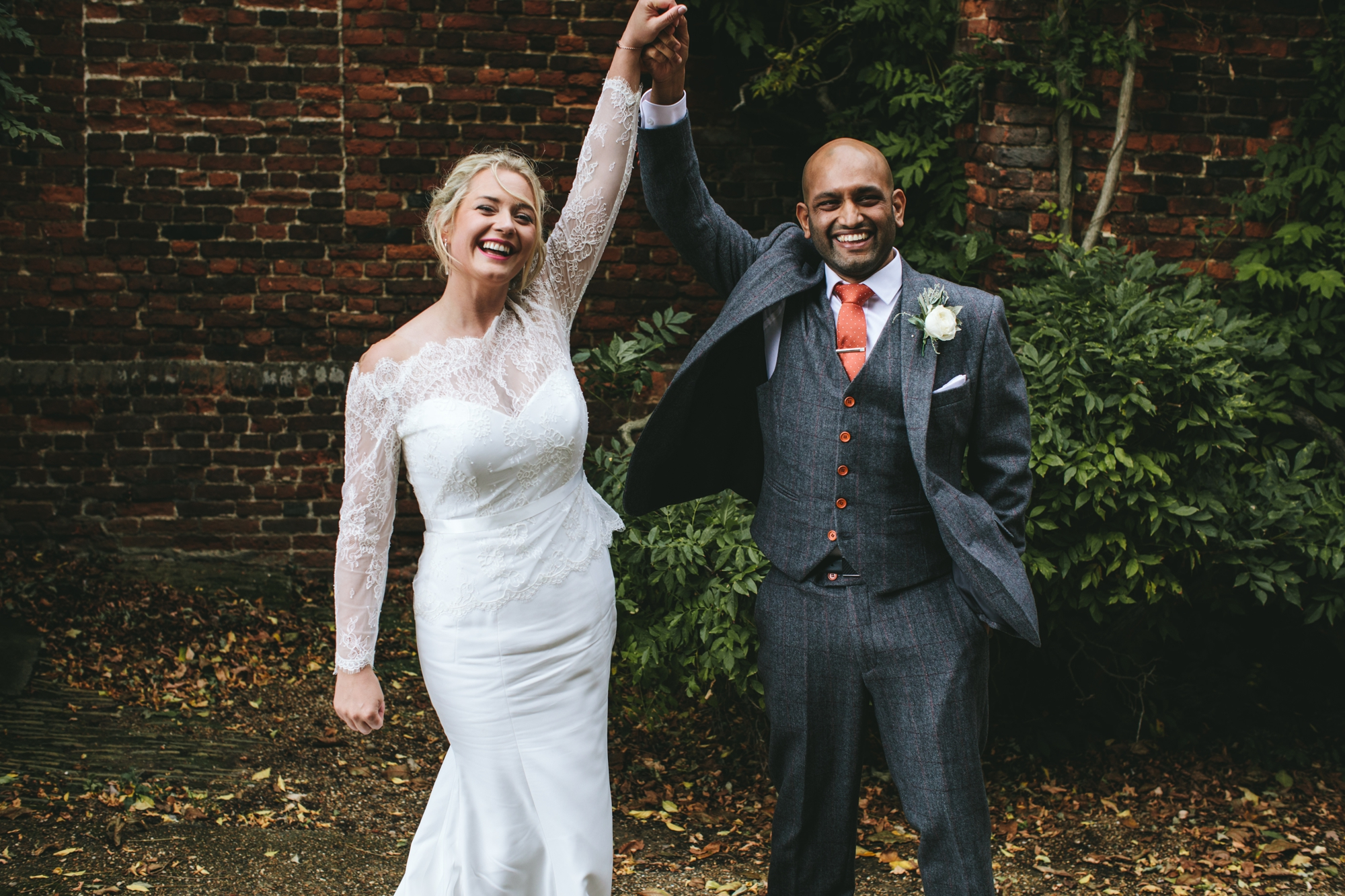 A Suzanne Neville Bride in a Classic, Long-Sleeved Lace Dress for a Celestial Inspired Wedding at Hatfield House